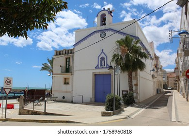 Les Cases d'Alcanar, Tarragona / Spain - June 13 2020: Worm's eye view on the renovated church captured in the village of Les Cases d'Alcanar