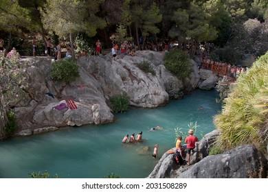 Les Fonts de l'Agar, Callosa, Spain - August 11 2010: People swimming and having fun at the water at Les Fonts de l'Agar