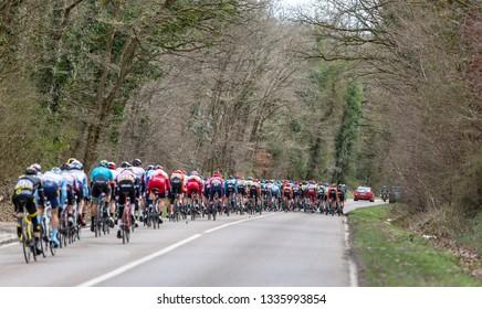 Les Granges-le-Roi, France - March 11, 2019: The peloton riding on Cote des Granges-le-Roi during the stage 2 of Paris-Nice 2019.