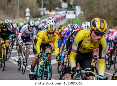 Les Granges-le-Roi, France - March 11, 2019: Dylan Groenewegen of Jumbo-Visma Team riding in the peloton on Cote des Granges-le-Roi during the stage 2 of Paris-Nice 2019.Dylan won the first two stages