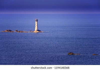 Les Hanois Lighthouse, built in 1862, off the western coast of Guernsey, United Kingdom.