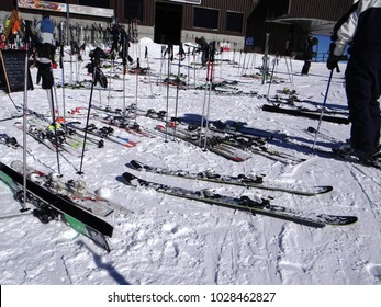 LES MOSSETTES, SWITZERLAND - FEB 13, 2018 - Skis on ski poles await their skiers at a restaurant on the border of Switzerland and France
