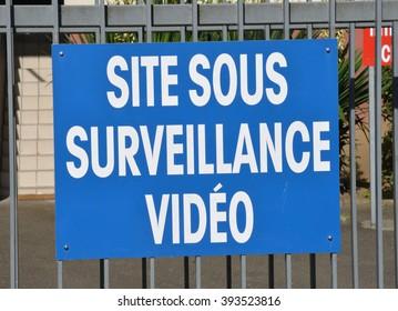 Les Mureaux, France - august june 7 2015 : video surveillance sign on a gate