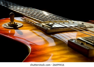 A Les Paul style guitar with sunlight beaming on it.