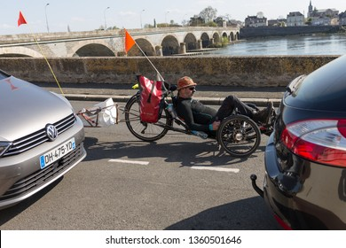 Les ponts de ce, Maine et Loire / France - March 31 2019: Man riding a recumbent bicycle in France along Loire river