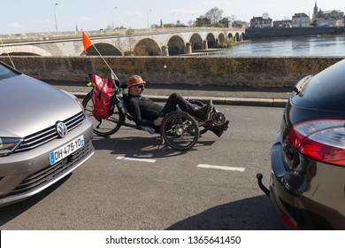 Les ponts de ce, Maine et Loire / France - March 31 2019: man riding a recumbent bike. cycling season 2019