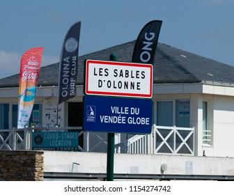 Les Sables d'Olonne France, 25 July 2018: Les Sables d Olonne town sign and Vendee globe yatch race logo