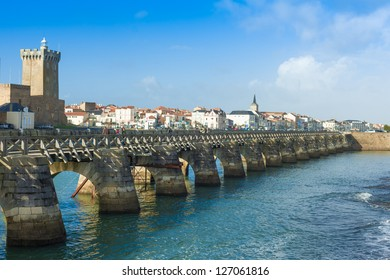LES SABLES D'OLONNE, FRANCE - DECEMBER 25. Sightseers on archway bridge on the Canal of La Chaume on December 25, 2012. The historical city attracts tourists all year long.