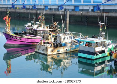 LES SABLES D'OLONNE, FRANCE - OCTOBER 30, 2016: Colorful fishing boats at the fishing port with reflections
