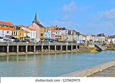 Les Sables-d'Olonne, Vendée / France- 6/5/2017: A view across the harbour channel towards La Chaume, a popular holiday destination, accessible by passenger ferry from Les Sables.