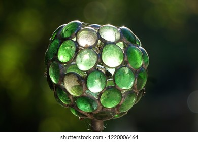 Les Clées, a special eye on a Swiss village - A green miror ball made of green glass and catching the sun
