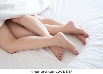 Lesbian, couple concept. two women are lesbian sleeping on white bed.