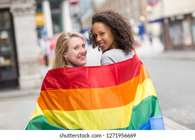 Lesbian couple with a LGBT flag