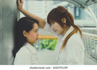 Lesbian couple make eye contact together with happiness outdoors concept, romance concept.