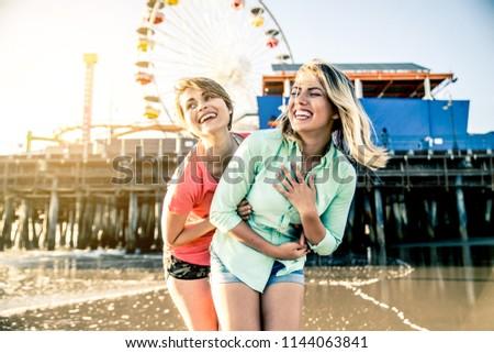 MAURA: Lesbians playing and having fun