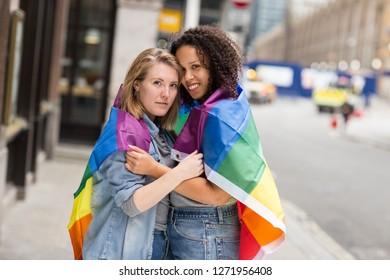 lesbian couple with a rainbow flag