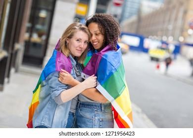 Lesbian couple with a rainbow LGBT flag
