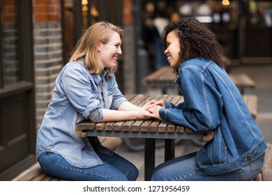 lesbian couple sitting together chatting