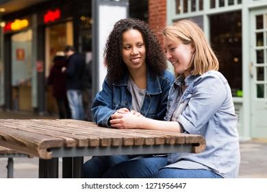 lesbian couple sitting together talking