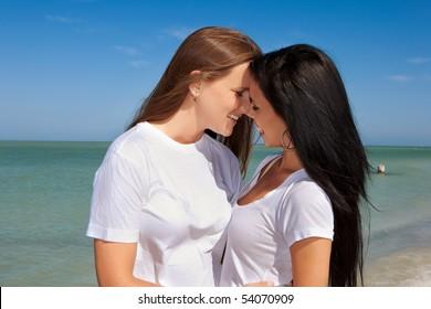 Lesbian couple standing on a beach