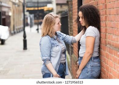 lesbian girl consoling her girlfriend