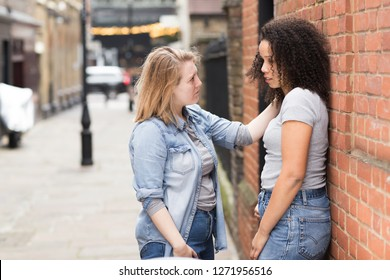 lesbian girl trying to cheer up her upset girlfriend