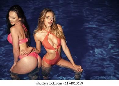 lesbian girls in love relationship on romantic beach. lesbian women in pool water, copy space.