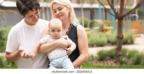 Lesbian interracial family. Two moms with their baby. unconventional family