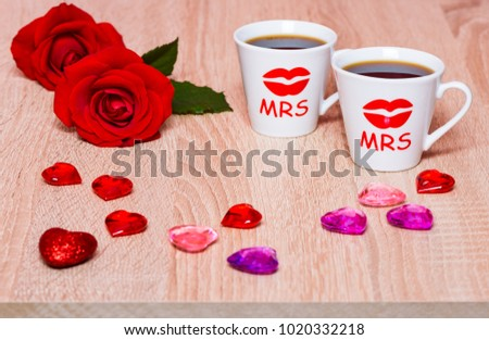 Two lesbians and cup