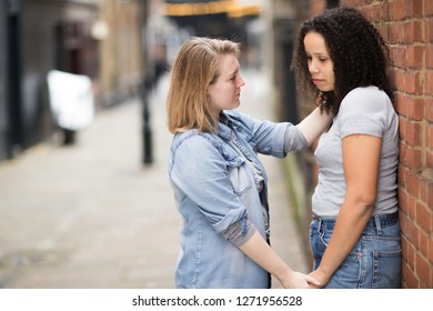 Lesbian woman comforting her girlfriend