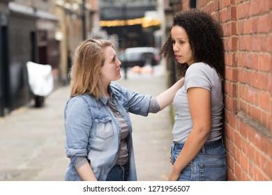 Lesbian woman consoling her upset girlfriend