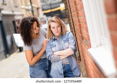 lesbian woman with her upset girlfriend