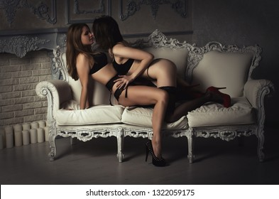 lesbians kiss in lingerie on the bed