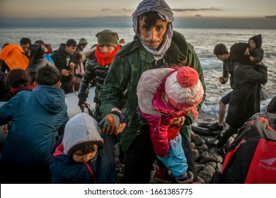 Lesbos, Greece, March 2, 2020: Refugees and Migrants aboard reach the Greek Island of Lesbos after crossing on a dinghy the Aegean sea from Turkey