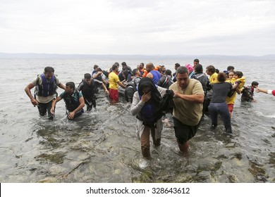 Lesbos, Greece, Oktober 11 2015: Refugees and Migrants aboard dinghies reach the Greek Island of Lesbos after crossing the Aegean sea from Turkey