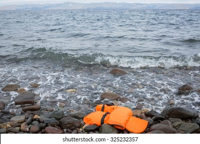 Lesbos, Greece - September 29, 2015: A life vest used by refugees can be seen on the shore