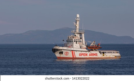LESBOS ISLAND, GREECE - MAY 3, 2019: Boat of Open Arms (an NGO to protect those  people who try to reach Europe fleeing from war, persecution or poverty) boat on sea getting ready to serve