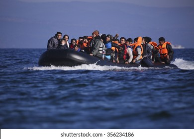 Lesbos island, Greece, November 13, 2015: Grroups of Refugees and Migrants aboard dinghies reach the Greek Island of Lesvos after crossing the cold Aegean sea from Turkey arriving thirsty and helpless