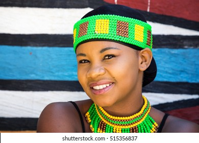 Lesedi Cultural Village, SOUTH AFRICA - 4 November 2016: Young Zulu woman in colouful traditional bead work costume.
