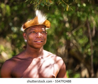 LESEDI CULTURAL VILLAGE, SOUTH AFRICA - NOVEMBER 4, 2016. Zulu warrior wearing traditional headdress. Zulu is one of the remaining tribes in South Africa.