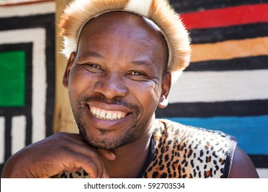 Lesedi Cultural Village, SOUTH AFRICA - 4 November 2016: Portrait of a Zulu Warrior wearing impala skin headdress. Zulu is one of the five main tribes in South Africa known for their fighting skills