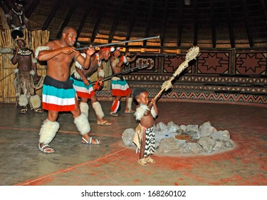 LESEDI CULTURAL VILLAGE,SOUTH AFRICA-JAN 1:Group of African Zulu dancers in ritual costumes entertaining and performing for tourists at Cultural Village Lesedi, South Africa on January 1, 2008.