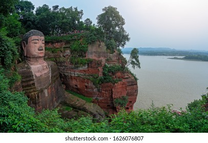Leshan, China -  July 2019 : The  Giant Leshan Buddha, a 71-meter tall stone statue built between 713 and 803 during the Tang Dynasty. Located at the confluence of the Minjiang, Dadu and Qingyi rivers
