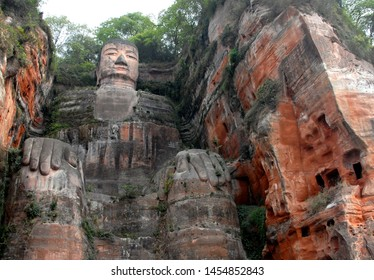 The Leshan Giant Buddha or Leshan Grand Buddha near Chengdu, Sichuan, China. The Leshan giant is the tallest stone Buddha statue in the world. View from a boat on the river near to Leshan and Chengdu.