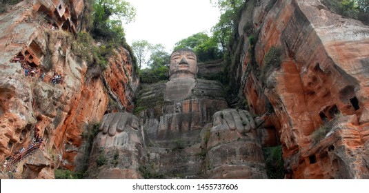 The Leshan Giant Buddha or Leshan Grand Buddha near Chengdu, Sichuan, China. This is the tallest stone Buddha statue in the world. View from the tourist boat on the river near to Leshan and Chengdu.
