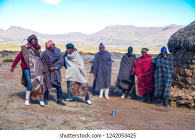 Lesotho - May 2018: A group of Lesotho men is doing a traditional dance for the tourist.