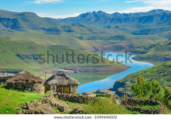 Lesotho traditional hut house homes in Lesotho village in Africa. Beautiful scenic landscape of village in daytime with typical huts built by villagers by the lake of Mohale Dam