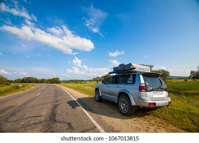 LESOZAVODSK, RUSSIA - AUGUST 16, 2014: Mitsubishi Pajero Sport with rooftop tent on a road
