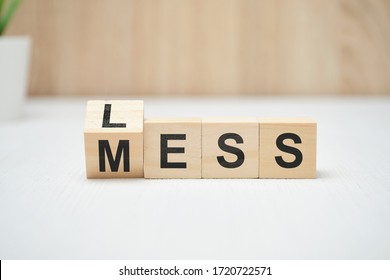 Less mess words on wooden blocks. Close up.