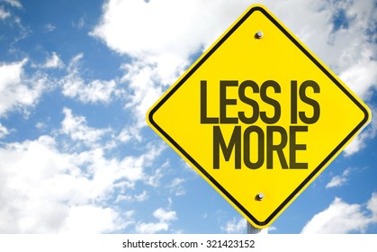Less Is More sign with sky background